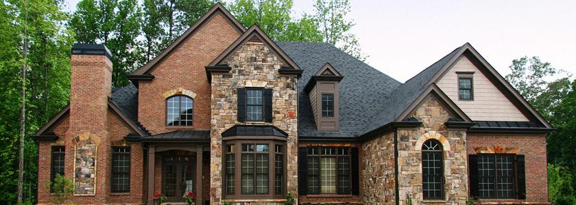 Каменные дома – обзор строительных материалов от ведущих производителей